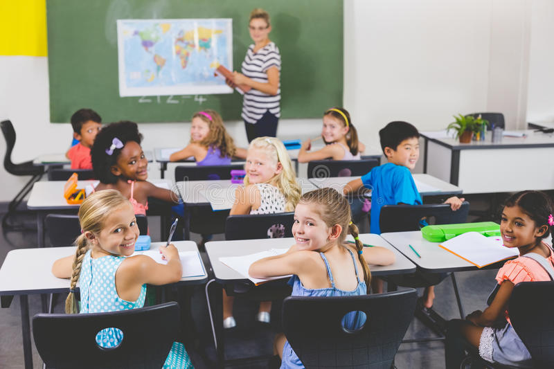 School kids smiling during geography class royalty free stock images