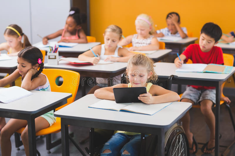 School kids studying in classroom royalty free stock photography