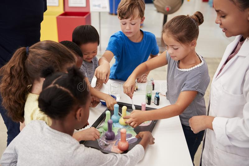 School kids taking part in experiment at science centre stock photography
