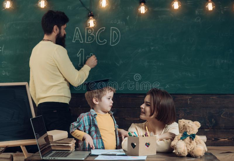 School lesson concept. Teacher give school lesson in mathematics for little kid. First school lesson. Family and child royalty free stock photo