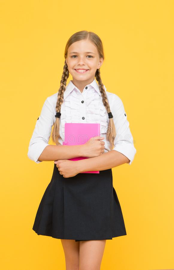 School lesson. Study literature. Inspirational quotes motivate kids for academic year ahead. School girl formal uniform royalty free stock image