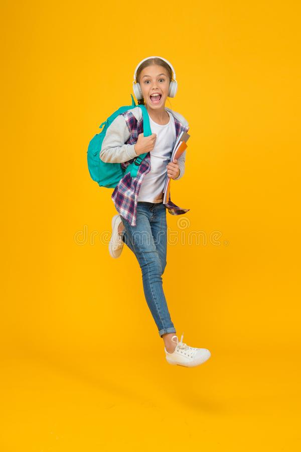 School daily life. Happy carefree child. School and leisure. Modern education. Energetic cheerful teen listening music royalty free stock photo