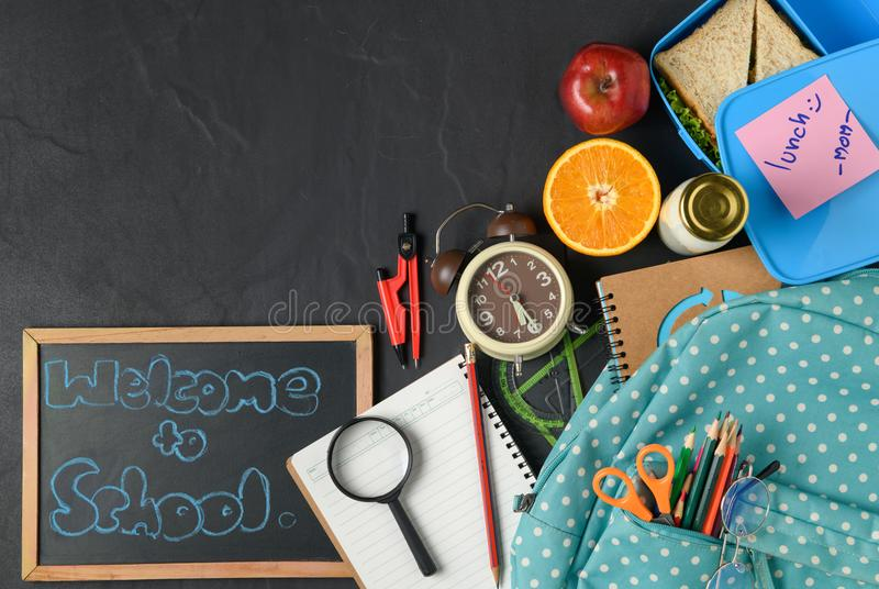 School lunch box and fruit for kids with backpack royalty free stock images