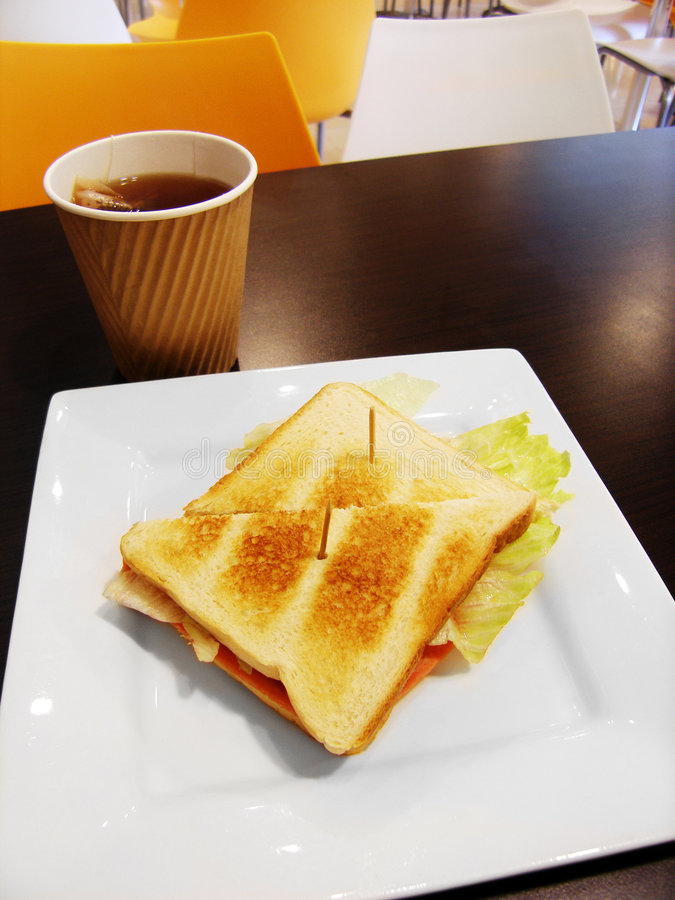 School lunch in campus cafeteria, grilled sandwich stock photography