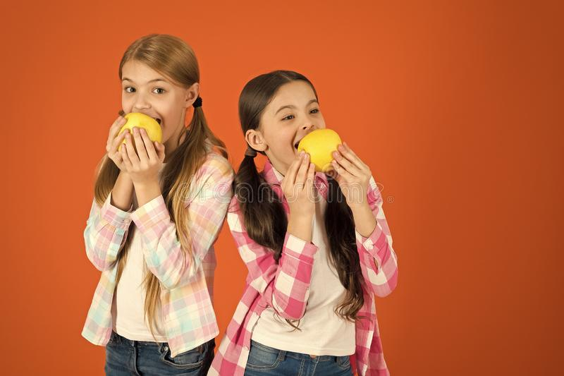 School lunch. Vitamin fruit nutrition for children. Healthy lifestyle. Distributing free fresh fruit at school. Girls royalty free stock images