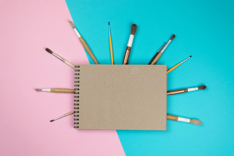 School notebook and various stationery. Back to school concept. stock photo