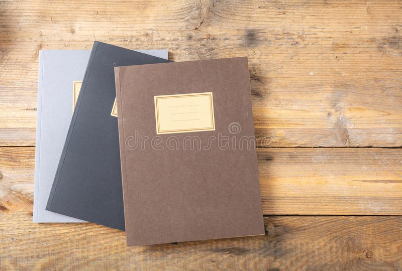 School notebooks stack, old fashioned, isolated on white background, blank label, copy space. School notebooks stack, old fashioned, isolated on wooden royalty free stock photography