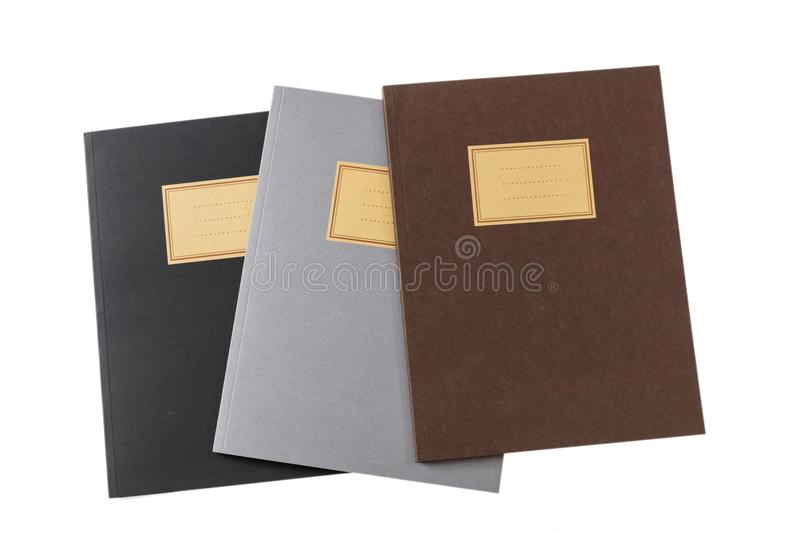 School notebooks stack, old fashioned, isolated on white background, blank label, copy space, top view. School notebooks stack, old fashioned, isolated on white royalty free stock photo