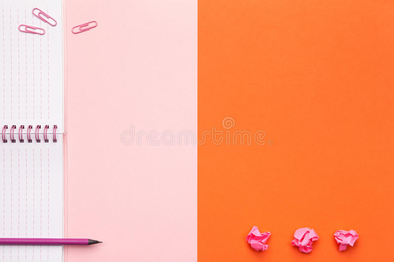 School or Office Accessories on Pink and Orange Background stock photo