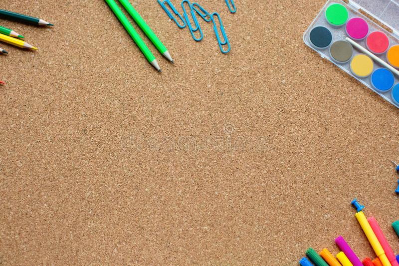 School and office accessory with copy space on cork background. royalty free stock image
