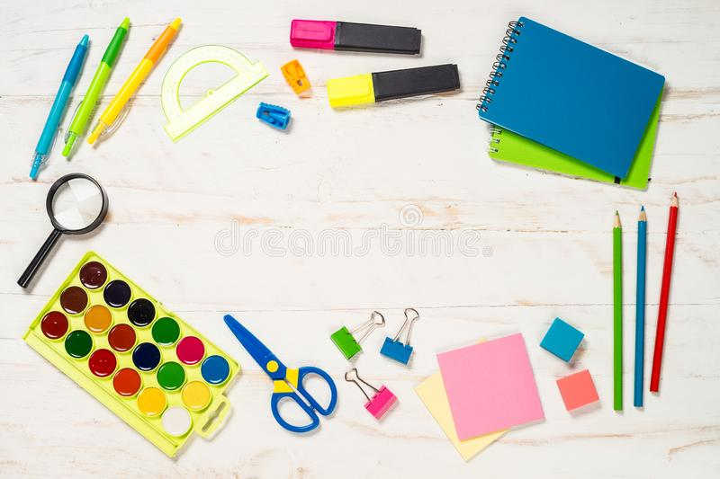 School and office sstationery on white background. Notebook, notepad, pen, pencils, loupe, paper clips and other. Top view with copy space stock photo