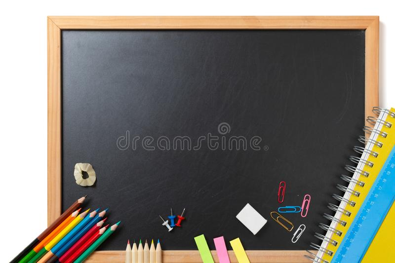 School and office supplies on blackboard background. Back to school concept with stationery supplies and chalkboard stock image