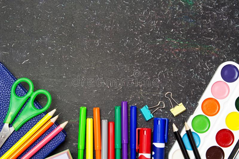 School and office supplies on a blackboard. Stationery stock photo