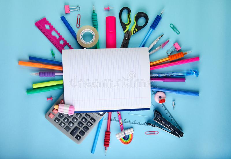 School office supplies on a blue background with copy space. Back to school stock photography
