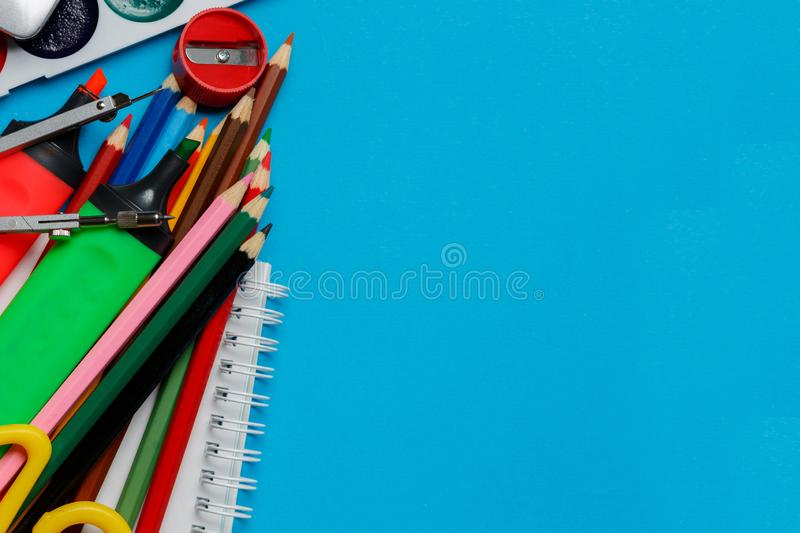 School office supplies on blue background royalty free stock images