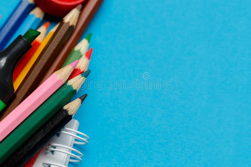 Back to school concept - school office supplies on blue paper stock photos
