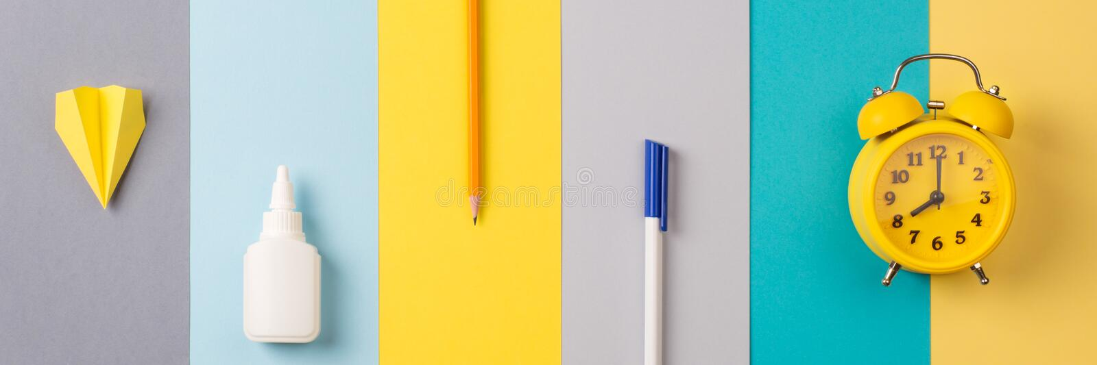School and office supplies on bright striped background. concept: back to school, minimalism. long banner stock photo