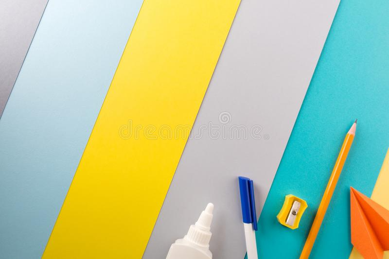 School and office supplies on bright striped background. concept: back to school, minimalism. stock images