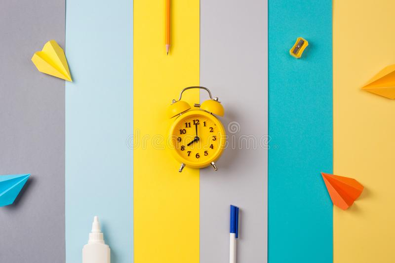 School and office supplies on bright striped background. concept: back to school, minimalism. stock image
