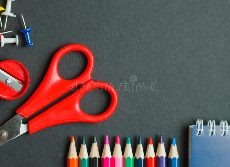School and office supplies on dark background. Top view with copy space royalty free stock image