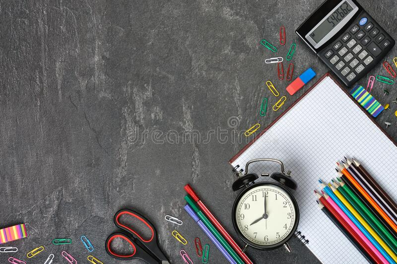 School and office supplies on gray background. stock photos