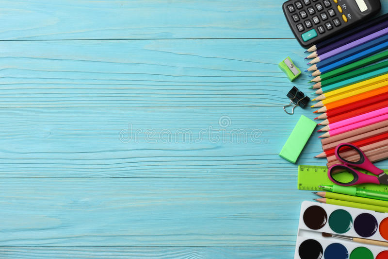 School and office supplies. school background. colored pencils, pen, pains, paper for school and student education. On wooden background. top view with copy stock images