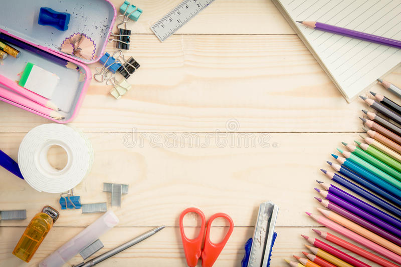 School and office supplies on wood background. Back to school. School and office supplies on wood background. Back to school royalty free stock image