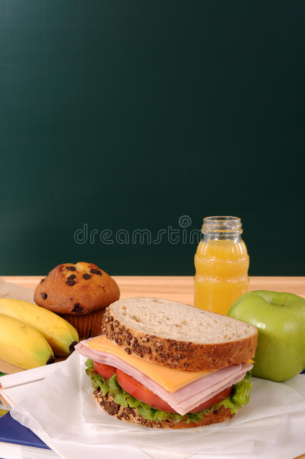 School packed lunch sandwich, apple, drink with blackboard, copy space, vertical stock images