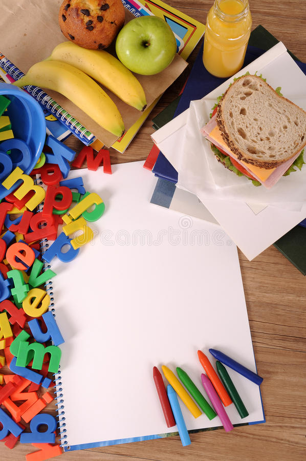 School packed lunch sandwich, apple, drink on school desk or table, copy space, vertical royalty free stock photo