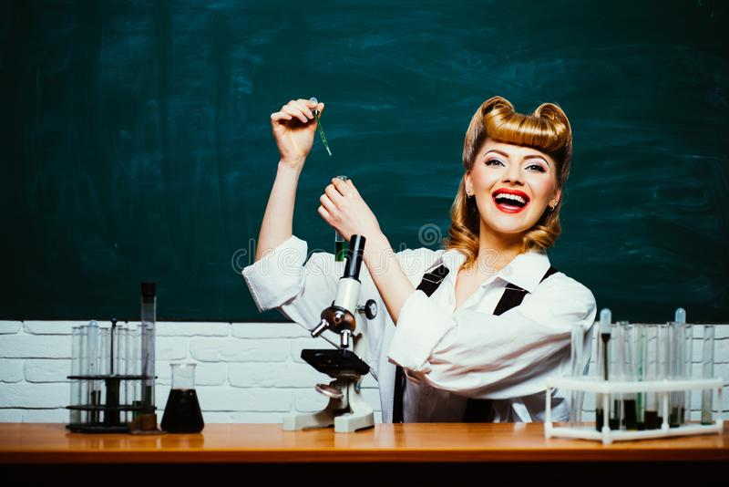 School science. Teacher of biology or chemistry. Laboratory experiments. School education. Lessons with research stock photography