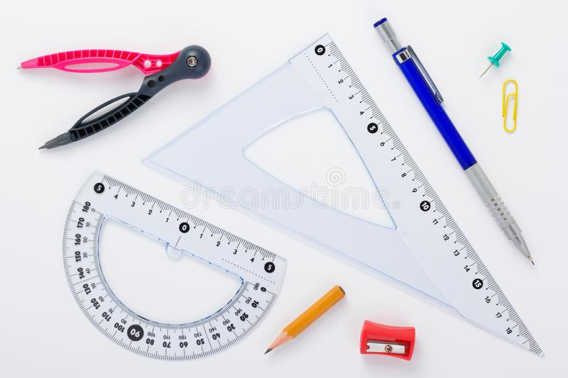 School set and ruler at white background royalty free stock photography