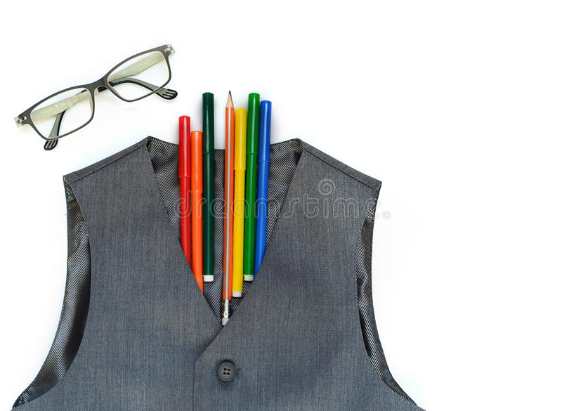 School set with vest, pencils, felt-tip pens, and glasses on a white background. School.Back to school.education concept stock image