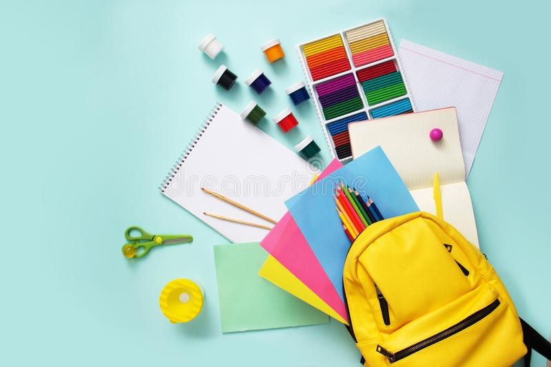 School stationary supplies sets and knapsack on blue background. Top view. School stationary supplies sets and knapsack on blue background. Top view royalty free stock photos