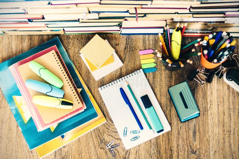 School stationery accessories - notebook, copybook stack with plastic holder pencils, pens, markers, paper clips, stickers, royalty free stock image