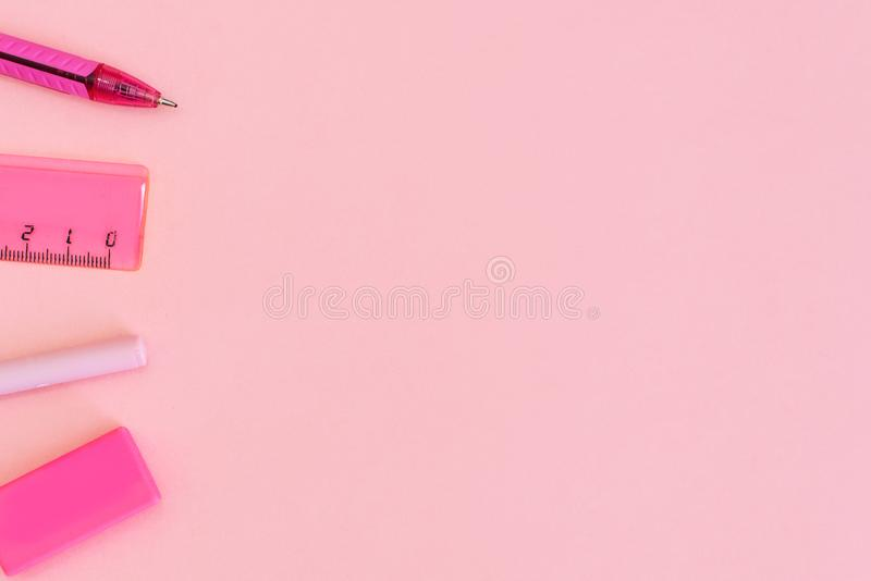 School stationery on a pink background. Back to school creative illustration, template stock photo