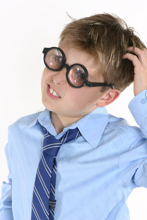 School student in comical spectacles and a confusedl expression stock photography