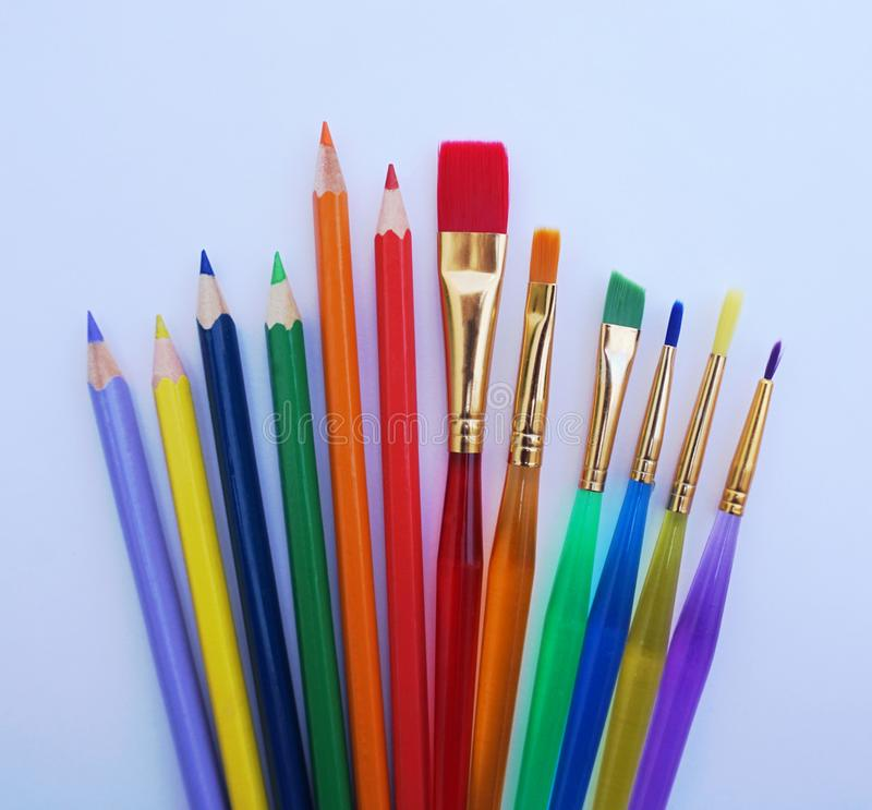 School stuff for art education, wooden color pencil and paint brushes in several colors royalty free stock images
