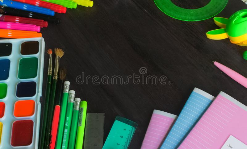 School supplies and accessories on blackboard background. concept Back to school royalty free stock photos