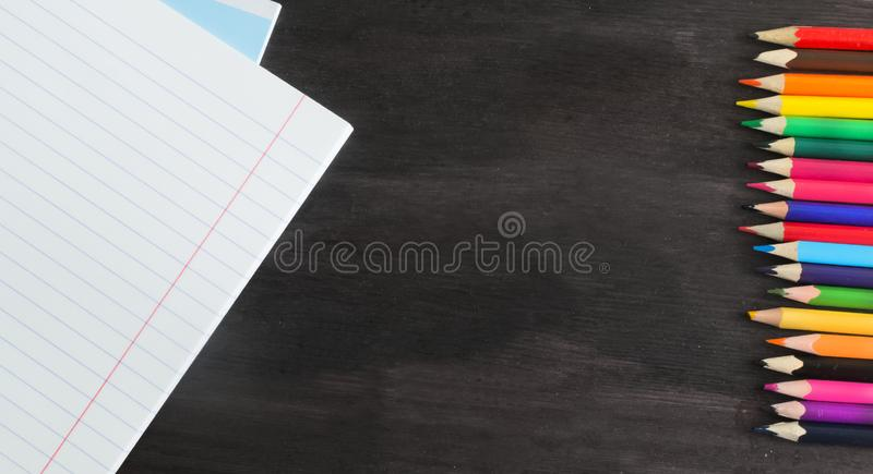 School supplies and accessories on blackboard background. concept Back to school stock images