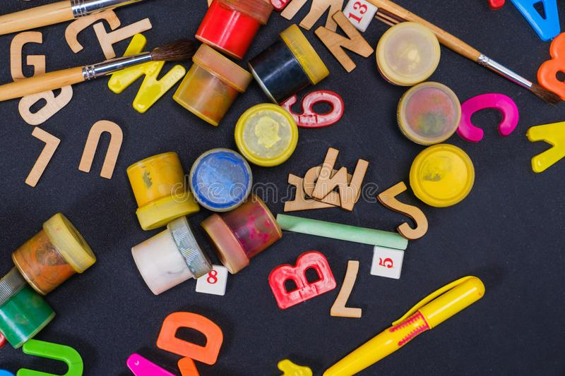 School supplies on black board background royalty free stock photos