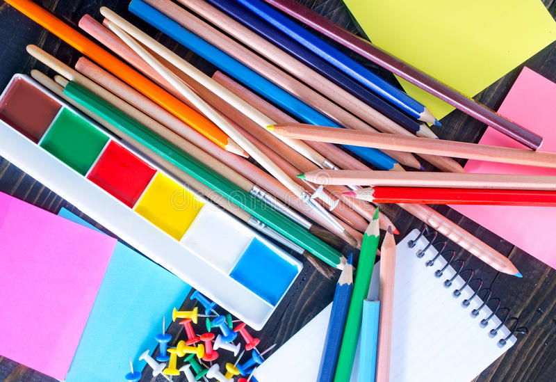 School supplies. And black board on a table stock photography