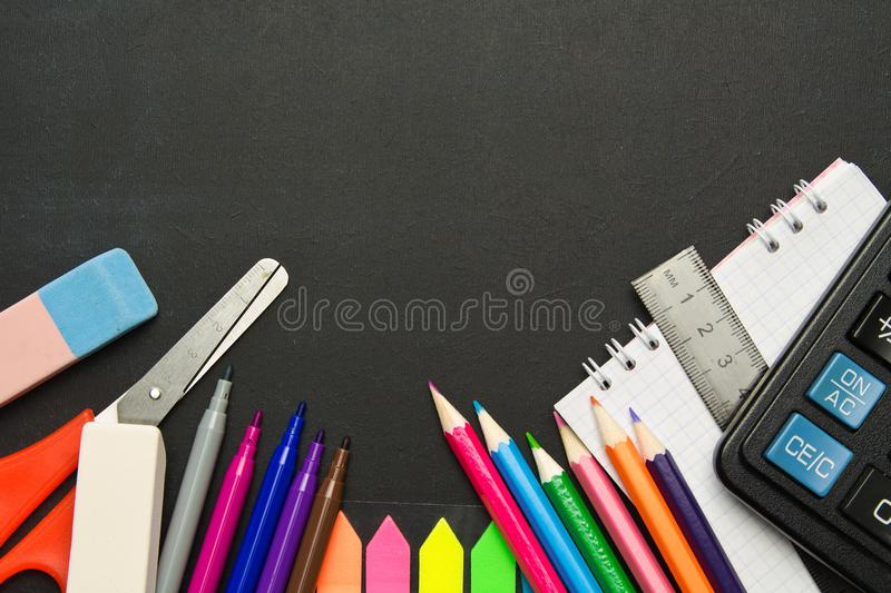 School supplies on blackboard background . The concept of education, study, learning, elearning. Back to school royalty free stock image