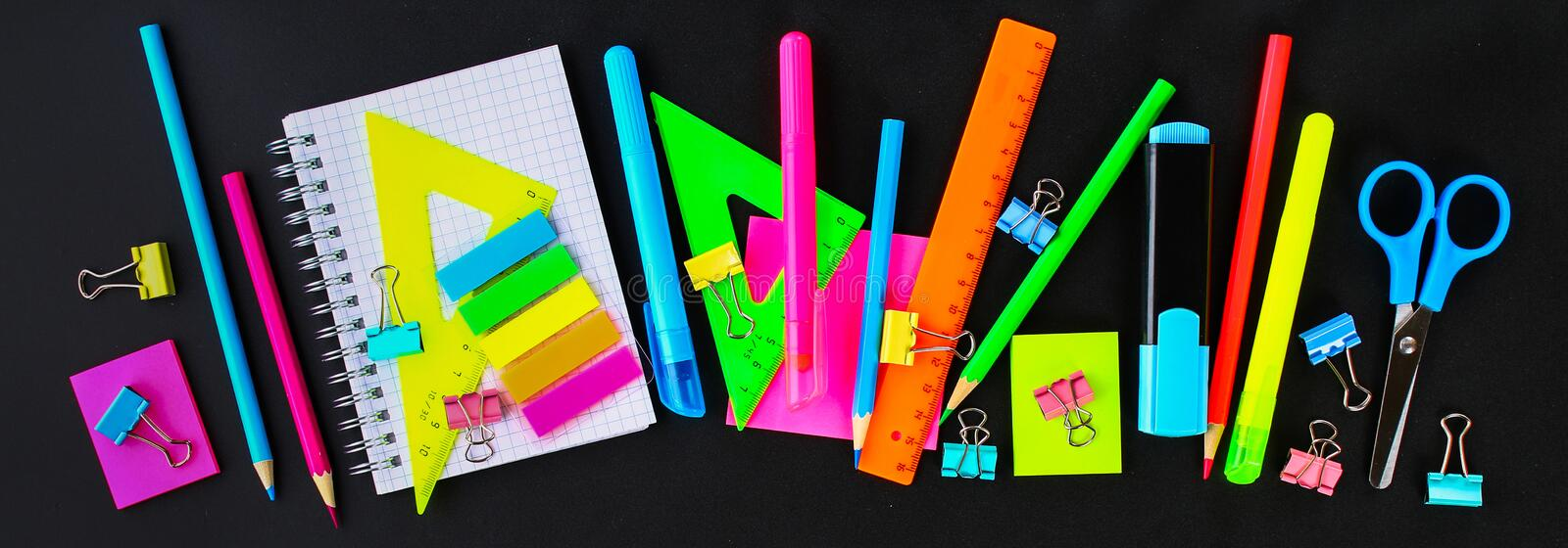 School supplies on blackboard background ready for your design. Flat lay. Top view. School supplies on blackboard background ready for your design. Flat lay royalty free stock images