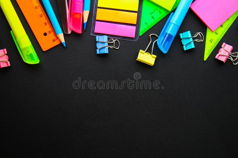School supplies on blackboard background ready for your design. Flat lay. Top view. Copy space. School supplies on blackboard background ready for your design royalty free stock photos