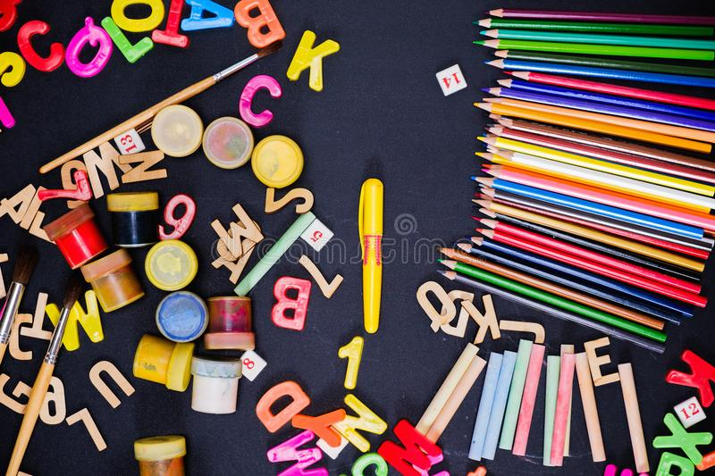 School supplies on blackboard background royalty free stock photography