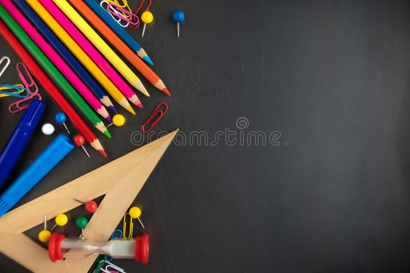 School supplies on blackboard background, top view. Back to school and Education concept. Flat lay, copy space royalty free stock photos