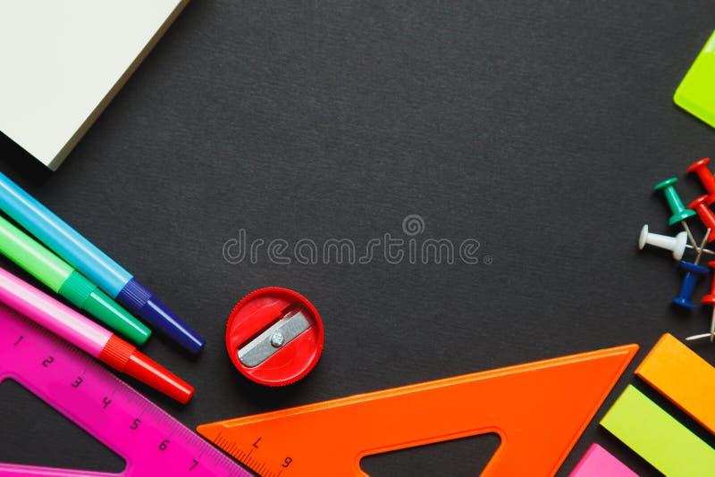 School supplies on blackboard stock photos