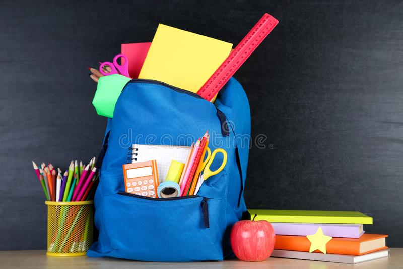 School supplies with backpack stock photo