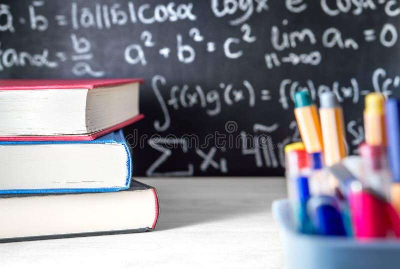 School supplies in classroom. Blackboard or chalkboard in class. royalty free stock image