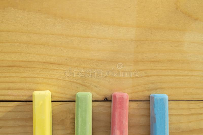 School supplies colored crayons on a light background of the Board stationery. Back to school, the concept of minimalism, flat lay stock photos